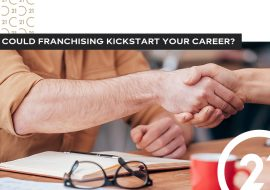 franchising - two hands in the middle of handshaking